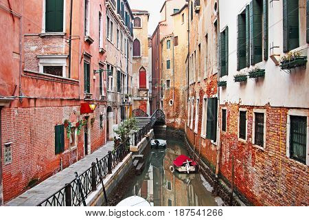 Old Canal Surrounded By Historic Buildings In Venice, Italy