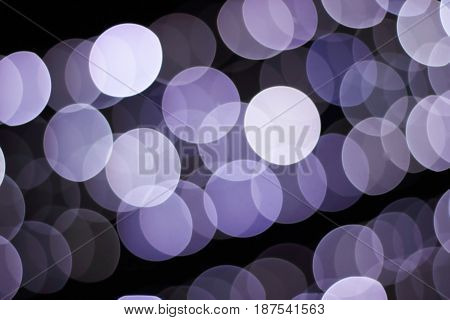 Blue bokeh of the lights of the night city. Defocused background.