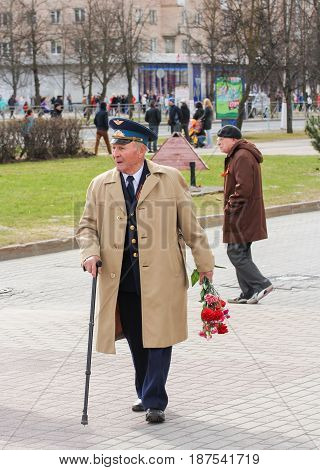 Kirishi, Russia - 9 May, Veteran with flowers, 9 May, 2017. Preparation and conduct of the action Immortal regiment in small cities of Russia.
