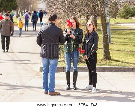 Kirishi, Russia - 9 May, Young people with carnations, 9 May, 2017. Preparation and conduct of the action Immortal regiment in small cities of Russia.