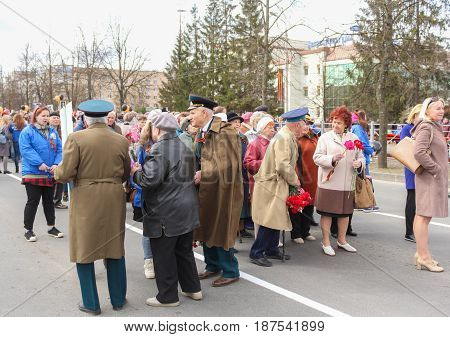 Kirishi, Russia - 9 May, Older people are waiting for the start of the action, 9 May, 2017. Preparation and conduct of the action Immortal regiment in small cities of Russia.