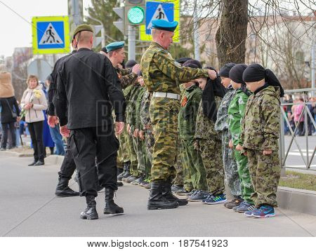 Kirishi, Russia - 9 May, Group of teenagers in uniform, 9 May, 2017. Preparation and conduct of the action Immortal regiment in small cities of Russia.