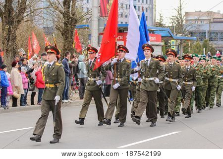 Kirishi, Russia - 9 May, Procession of the group with flags, 9 May, 2017. Preparation and conduct of the action Immortal regiment in small cities of Russia.