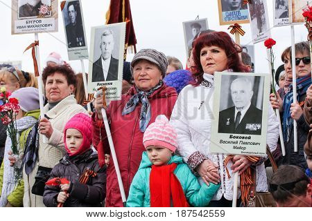 Kirishi, Russia - 9 May, People with portraits and St. George ribbons, 9 May, 2017. Holding a festive rally dedicated to the Victory Day.