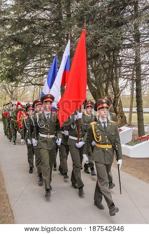Kirishi, Russia - 9 May, Ceremonial group with flags, 9 May, 2017. Laying wreaths and flowers in memory of the fallen at the Eternal Flame.