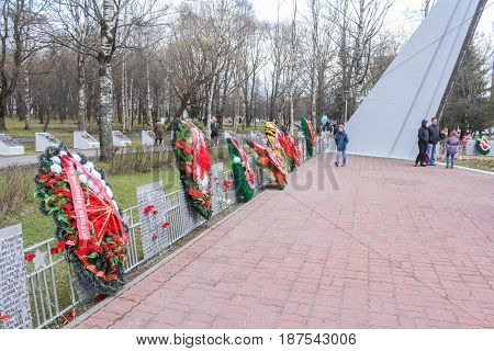 Kirishi, Russia - 9 May, Wreaths on the fence with memorable signs, 9 May, 2017. Laying wreaths and flowers in memory of the fallen at the Eternal Flame.
