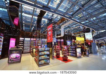 BANGKOK THAILAND- MAY 16 2017: Unidentified people shop food at a duty free shop at the International Airport Suvarnabhumi which is the sixth busiest airport in Asia.