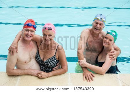 Portrait of senior couples enjoying in pool