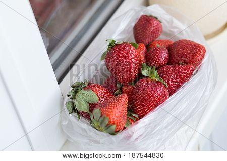 fresh ripe useful fruit strawberry in tray closeup