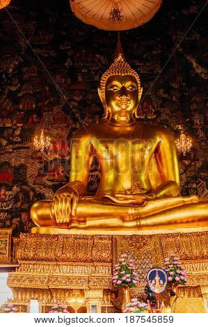 Giant Buddha In One Of The Temples In Bangkok In Lotus Pose