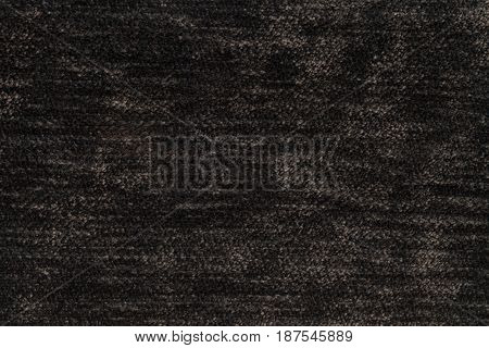 Dark brown background of soft fleecy cloth. Texture of light umber nappy textile closeup.