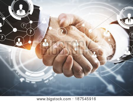 Close up of handshake with abstract digital pattern. Partnership concept