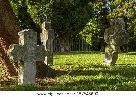 Gothic cross and tomb in cemetery at Saint-Hubert church, Aubel