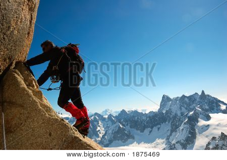 Male climber Rock-climbing sport horizontal orientation day light; Mont Blanc massif poster