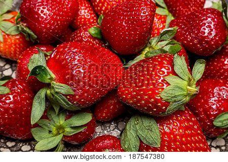 background from fresh ripe useful fruit strawberry closeup