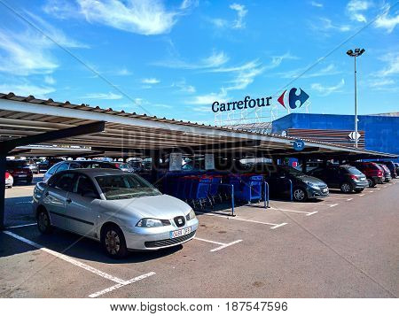 Torrevieja Spain - March 17 2017: Parking and facade of Carrefour hypermarket. Carrefour is a French multinational retailer and one of the largest hypermarket chains in the world