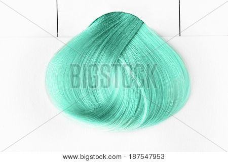 Trendy hairstyle ideas. Sample of mint hair color on white background