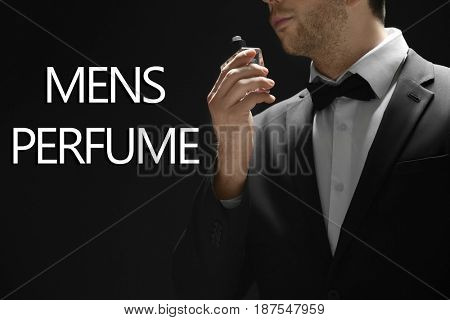 Men's perfume. Man with bottle of cologne and text on black background