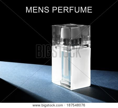 Men's perfume. Bottle of cologne and text on black background