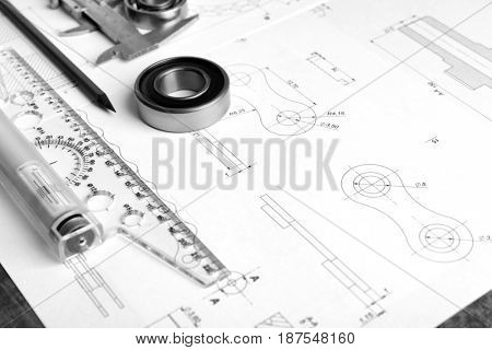 Engineering supplies and blueprints on workplace