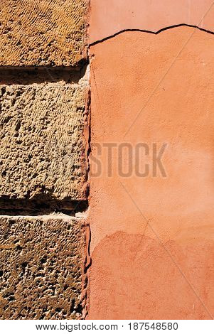 Detail of brick-plaster wall in ocher color