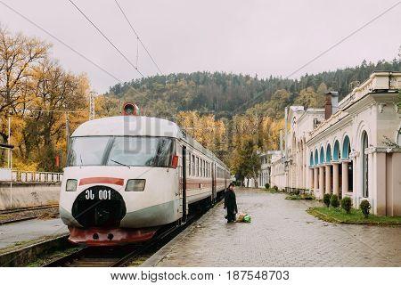 Borjomi, Samtskhe-Javakheti, Georgia - October 25, 2016: Woman Standing Near Train In Borjomi Parki Railway Station Building In Autumn Day