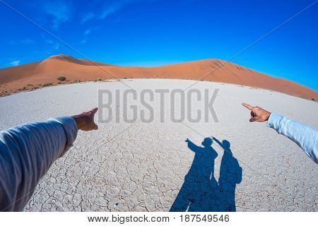 Fingers Pointing To The Scenic Sand Dunes Of Sossusvlei, Namib Naukluft National Park, Namibia, Afri