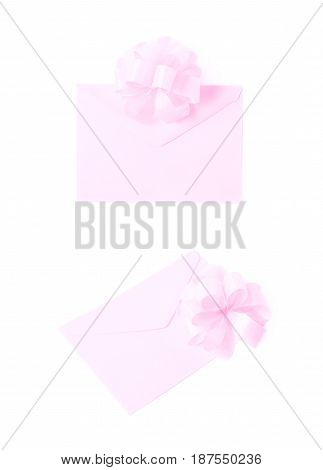 Paper envelope decorated with the bow isolated over the white background, set of two different foreshortenings