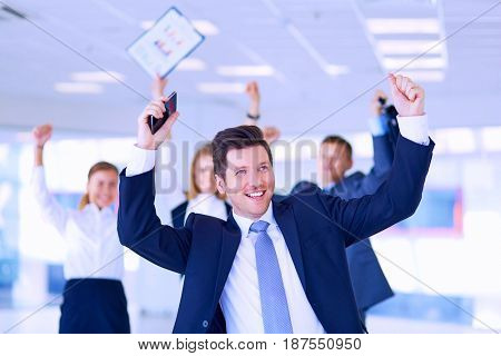 Business team celebrating a triumph with arms up