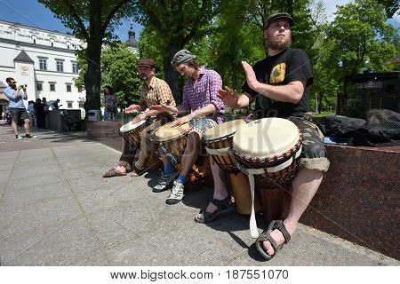 VILNIUS LITHUANIA - MAY 20: Unidentified musician play drums and other instrument in Street Music Day on May 20 2017 in Vilnius. Its a most popular event on May in Vilnius Lithuania
