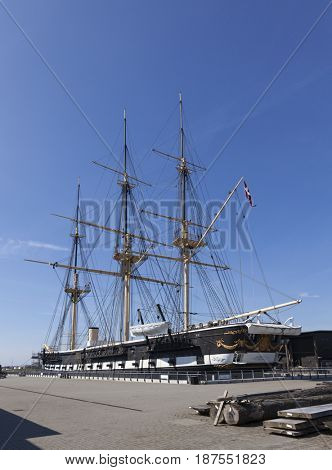 Ebeltoft, Denmark - May 1, 2017: Wooden frigate JYLLAND at the museum dedicated to her. It is one of the world's largest wooden warships, and is both screw-propelled steam frigate and sail ship.