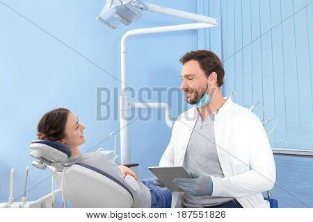 Young woman visiting dentist at clinic
