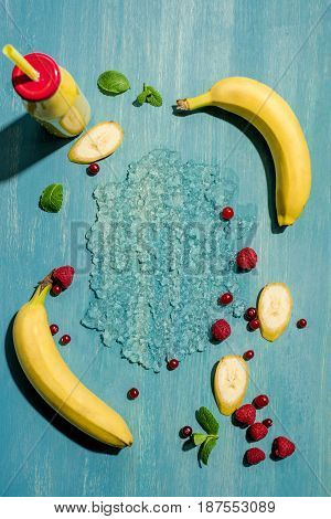 Top View Of Bottle With Fresh Banana Smoothie And Berries With Mint Leaves, Smoothie Fruits