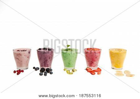 Close-up View Of Fresh Fruit Smoothies In Glass Cups Isolated On White