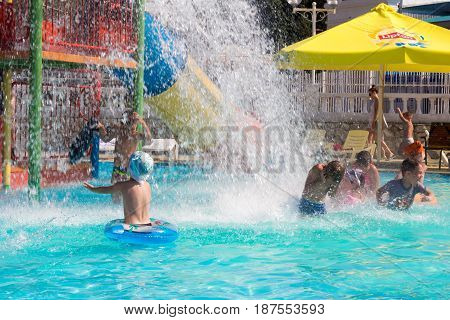 Gelendzhik Russia - July 30 2016 - Happy children having fun in the water Park pool with splashes of water