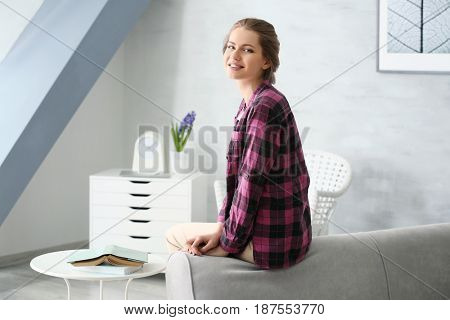Beautiful young woman resting at home