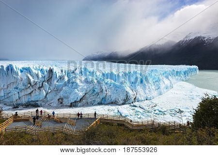 Perito Moreno Glacier Argentina - October 26 2013: Tourists looking at the Perito Moreno Glacier in the Los Glaciares National Park Patagonia region Argentina.