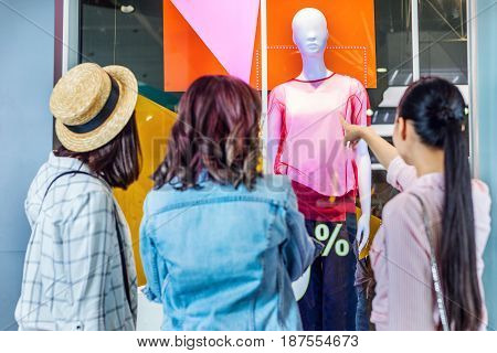 Young Hipster Girls Looking At Showcase In Shopping Mall, Friends Shopping Concept