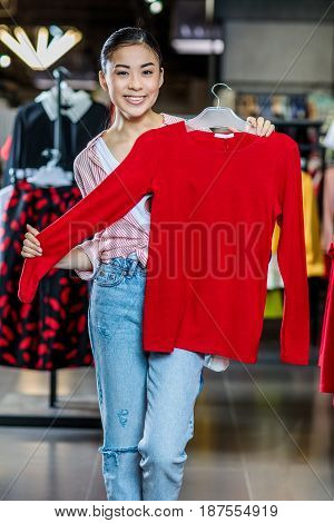 Asian Hipster Girl Choosing Clothes In Shopping Mall, Boutique Shopping Concept