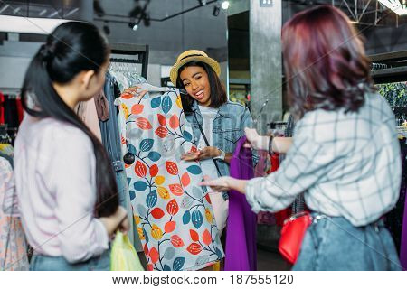 African American Hipster Girl With Friends Choosing Clothes In Boutique, Fashion Shopping Girls Conc