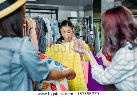 Asian Hipster Girl With Friends Choosing Clothes In Boutique, Fashion Shopping Girls Concept