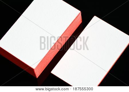 thick white cotton paper business card mock up with golden foil on the edges