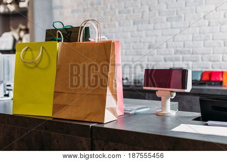 shopping bags standing on cash register in shopping mall boutique shopping concept