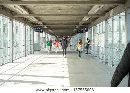 Regensburg Germany-May 20 2017: People walk on a concourse over the railroad tracks at Regensburg Central Station