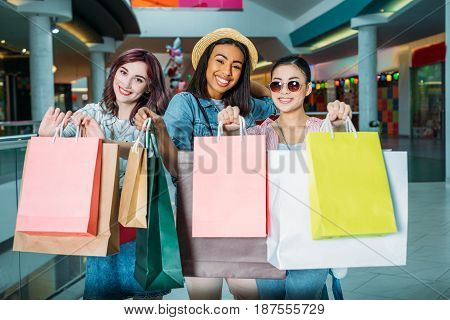 Beautiful Stylish Young Women Showing Shopping Bags And Smiling, Young Girls Shopping Concept
