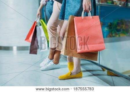 Cropped Shot Of Young Women With Shopping Bags Standing In Shopping Mall, Young Girls Shopping Conce