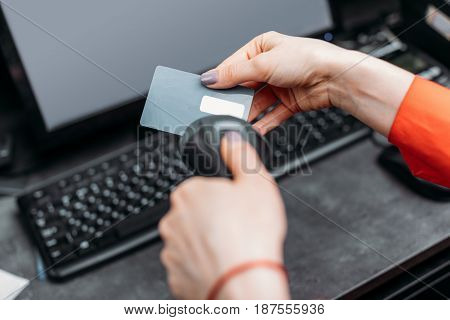 Close-up Partial View Of Person Using Payment Terminal And Scanning Credit Card