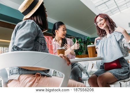 Stylish Young Women Sitting Together In Shopping Mall With New Fashionable Clothing, Young Girls Sho