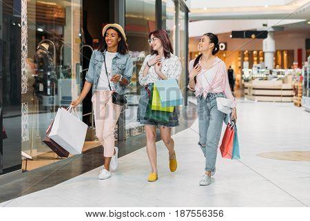 Stylish Young Smiling Women Walking With Shopping Bags, Young Girls Shopping Concept