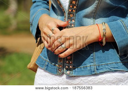 Loom bracelets on a young girl's hand. Close up. Young fashion concept